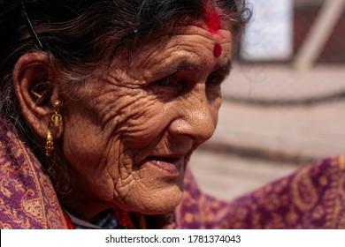 Kathmandu Nepal - April 5, 2018 - A clope up portrait of an old lady in Kathmandu Durbar Square Nepal.