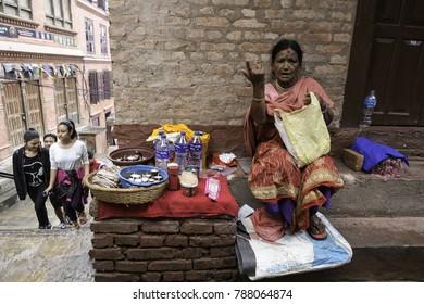 Kathmandu, Nepal - August 12, 2017 : A female Nepali grocery shop owner in Monkey temple, Kathmandu city