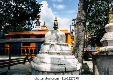 Kathmandu Nepal August 23, 2018 View of white stupa located at the botton of the Monkey temple Swayambhunath area in Kathmandu in the evening