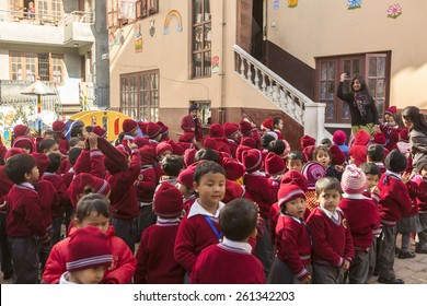 KATHMANDU, NEPAL - CIRCA DEC, 2013: Unknown pupils during dance lesson in primary school. In Nepal only 25% of girls attend schools and half of the children can reach the 5 grade.