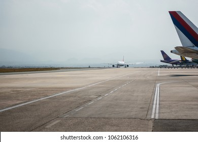 KATHMANDU, NEPAL - CIRCA MARCH 2108: Airplane taxiing at Tribhuvan International Airport.