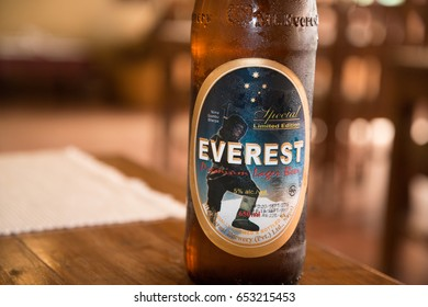 Kathmandu, Nepal, circa may 2017: Everest beer bottle on the table in restaurant. Everest is a favourite beer in Nepal