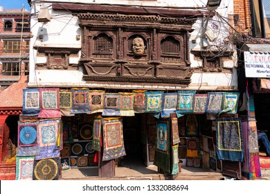 KATHMANDU, NEPAL - DEC 10, 2018: Front of the store with hand made shawls, table runners, material and all kind of souvenirs and fabrics.