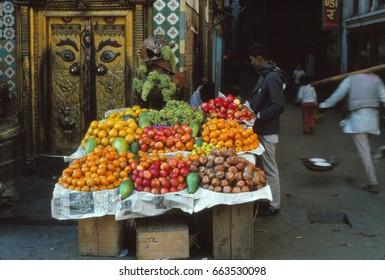 KATHMANDU, NEPAL - DEC 20, 1977 - Fruit seller's cart in old city of Kathmandu, Nepal