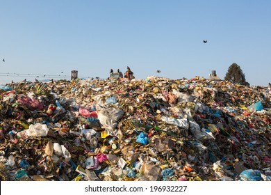 KATHMANDU, NEPAL - DEC 22, 2013: Food and pile of domestic garbage in landfill. Only 35% of population have access to adequate sanitation.