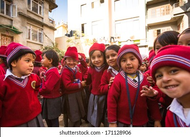 KATHMANDU, NEPAL - DEC 22: Unknown pupils during lesson in primary school, Dec 22, 2013 in Kathmandu, Nepal. Only only 25% of girls attend schools and half of the children can reach the 5 grade.