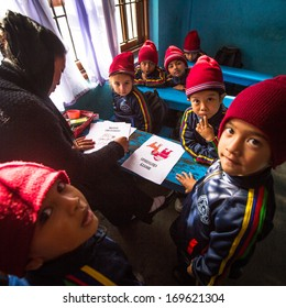 KATHMANDU, NEPAL - DEC 24, 2013: Unknown pupils in English class during preparation of Christmas at primary school, Dec 24, 2013 in Kathmandu, Nepal. Only 50% of  children in Nepal can reach 5th grade.