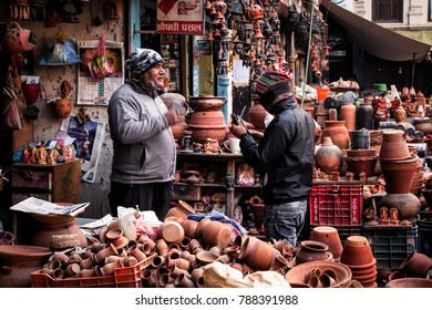 KATHMANDU, NEPAL - December 15, 2017 : Unidentified Nepali men are talking about buying some products from the shop.