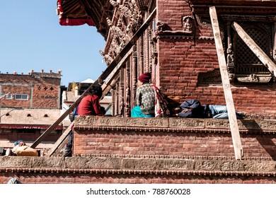 KATHMANDU, NEPAL - December 15, 2017 : Unknown people are sitting inside the Kathmandu Dubar Square.