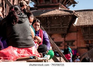KATHMANDU, NEPAL - DECEMBER 16,2017: Unidentified people siting in the Kathmandu dubar square.