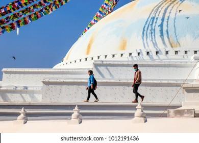 Kathmandu, Nepal - December 17, 2017 : People walking on Boudhanath, the biggest stupa in Kathmandu, Napal.
