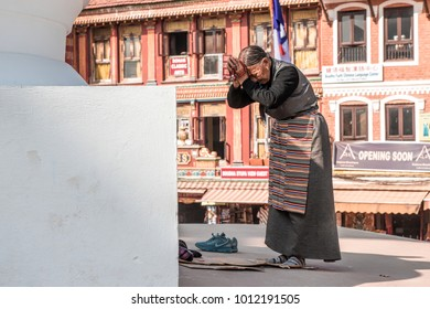 Kathmandu, Nepal - December 17, 2017 : Old lady are paying worship to the biggest stupa in Kathmandu, Boudhanath Stupa.