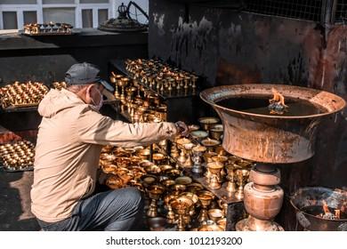 Kathmandu, Nepal - December 17, 2017 : People in Nepal are firing the candle for worship to the stupa in Kathmandu.