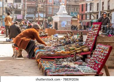 KATHMANDU, NEPAL - December 24, 2017 : Unidentified people are selling products in the Kathmandu dubar square market.