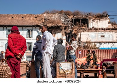 KATHMANDU, NEPAL - December 25, 2017 : Nepal people standing near the building that was collapsed by the earthquake in Kathmandu Dubar Square