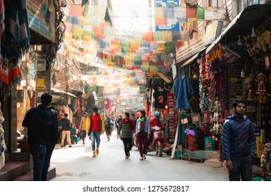 Kathmandu, Nepal - December 6, 2018: Crowd of people at busy market street of Thamel in the day.
