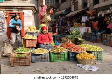 Kathmandu, Nepal - December 9, 2018: Woman selling fruits and vegetables at Asan market in the morning.