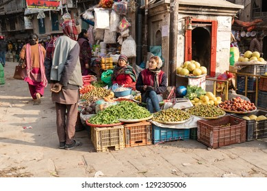 Kathmandu, Nepal - December 9, 2018: Women selling fruits and vegetables at Asan market in the morning.