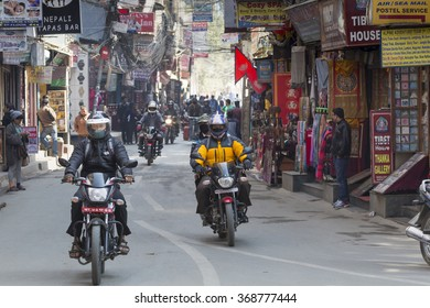 KATHMANDU, NEPAL - FEBRUARY 10, 2015: The streets of Kathmandu, Nepal, near Dubar square. Masses of people, rickshaws and Motorbikes crowd through the streets, 10, 2015 in Kathmandu, Nepal.