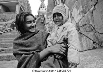 KATHMANDU, NEPAL - FEBRUARY 18, 2015: Two girls at the long upstairs to the Swayambhunath religious complex aka Monkey Temple - ancient religious complex, on the west of Kathmandu city.