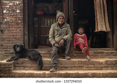 Kathmandu, Nepal - January 12, 2019:  traditionally dressed old Nepalese man and woman sitting on the street of the city.These old people usually spend their time within the neighborhood.
