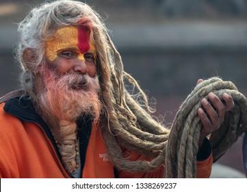 Kathmandu, Nepal- January 12, 2019: Sadhus with long hair and painted face in Pashupatinath temple in Kathmandu.