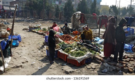KATHMANDU, NEPAL - JANUARY 20: hawker sell the fruits in a dirty market in kathmandu on 20 January 2010. The United Nations list Nepal as one of the Least developed country in the world