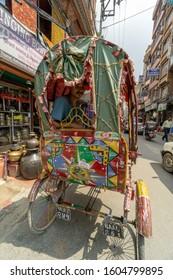Kathmandu, Nepal, June 17 2019: crowded streets, traffic shops and rickshaws waiting for customers.