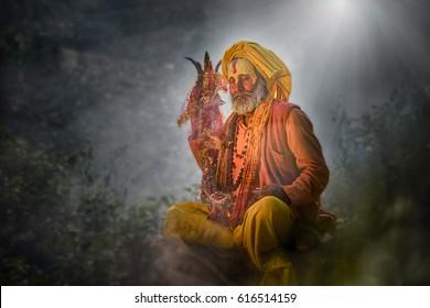 KATHMANDU, NEPAL - Mar 25: Holy Sadhu man with traditional painted face, blessing in Pashupatinath Temple. Mar 25, 2017 in Nepal, Kathmandu.