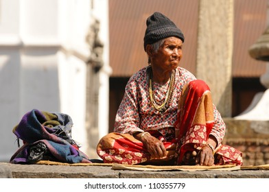 KATHMANDU, NEPAL - MARCH 16 - Old woman sit in the retirement home founded by Mother Teresa near Pashupatinath Temple, Kathmandu, Nepal on March 16, 2012