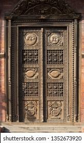 Kathmandu (Nepal) - March 16th, 2019: Pashupatinath temple. Detail of a wooden door