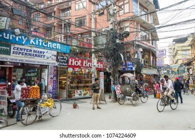 Kathmandu, Nepal - March 25, 2018: A sunny day on the narrow streets of Kathmandu March 25, 2018 in Kathmandu, Nepal.
