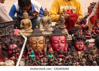 Kathmandu, Nepal - March 31, 2019: Buddhist artefacts for sale at a shop.