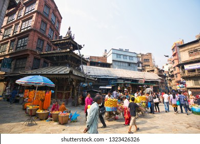KATHMANDU, NEPAL - MAY 03, 2014: Market streets in historic center of Kathmandu near Durbar Sqaure crowded with vendors and pedestrians
