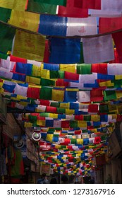 Kathmandu / Nepal - May 14 2018: Street in the shopping district in central Kathmandu with prayer flags above.