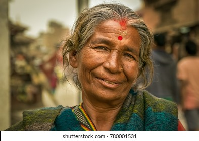 KATHMANDU, NEPAL MAY 15, 2017: Awesome portrait of old sweet woman nepalese with tika, traditional holy powder paintings in her face.