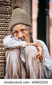 KATHMANDU, NEPAL - MAY 5, 2017 : Portrait of Poor man at Bhaktapur Durbar Square , Heritage site in Kathmandu, Nepal in May 5, 2017