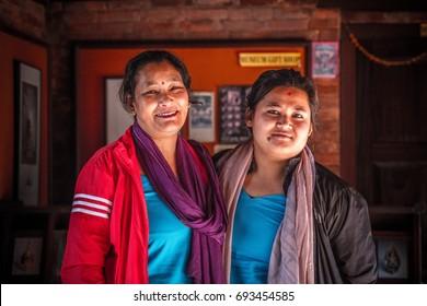 KATHMANDU, NEPAL - MAY 7, 2017 : Portrait of 2 unidentifies Nepalese women hug and happy at Pathan, Heritage site in Kathmandu, Nepal in May 7, 2017