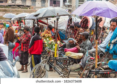 Kathmandu, Nepal - May 7, 2020: Rickshaw drivers in the old city center of Kathmandu wait for tourists. No Tourism in Nepal due to high number of covid-19 cases. Country is sealed off for Foreigners