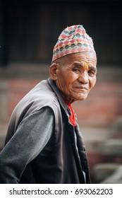 KATHMANDU, NEPAL - MAY 9,  2017 : Portrait of Nepalese man at Bhaktapur Durbar Square , Heritage site in Kathmandu, Nepal in May 9, 2017.