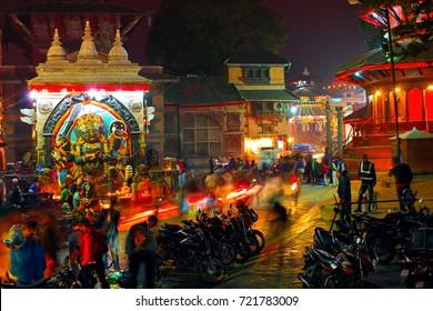 KATHMANDU, NEPAL - NOVEMBER 1: People move along Temple of Kala Bhairava (fierce manifestation of Lord Shiva) on famous Durbar Square at night on November 1, 2013 in Kathmandu
