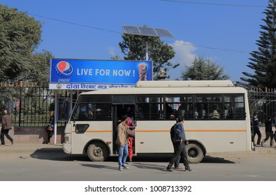 KATHMANDU NEPAL - NOVEMBER 10, 2017: Unidentified people travel by bus in Kathmandu Nepal.