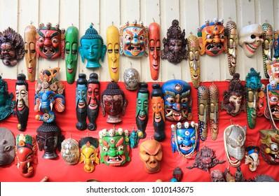 KATHMANDU NEPAL - NOVEMBER 10, 2017: Souvenir shop displays wooden masks in Kathmandu Nepal.