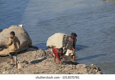 KATHMANDU NEPAL - NOVEMBER 11, 2017: Unidentified children play on river bank in Kathmandu Nepal.