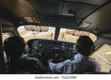 KATHMANDU, NEPAL - NOVEMBER 12, 2012: A sudden turn to avoid crosswinds while landing at Kathmandu airport in Nepal
