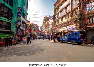 KATHMANDU NEPAL, NOVEMBER 18, 2018 - Crowdy shopping street with police patrol in Thamel, district of Kathmandu, Nepal.
