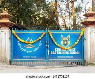 KATHMANDU, NEPAL - NOVEMBER 6, 2018: Nepal police celebrates Kukur Tihar (dog festival) at Central Police Dog Training School. The gate is decorated with marigold garlands.