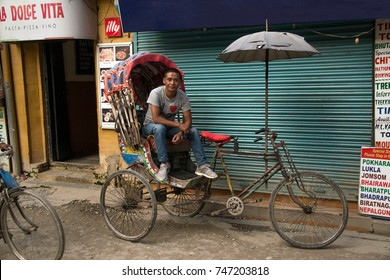 Kathmandu, Nepal – Oct 02, 2017: Rickshaw drivers are traditional modes or travel and are an important means of transportation in narrow streets of Kathmandu, Nepal