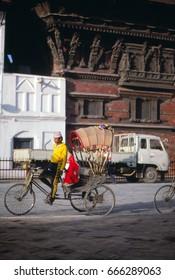 KATHMANDU NEPAL - OCT 8, 1986 -Bicycle rickshaw on street of old city of Kathmandu,Nepal, Asia