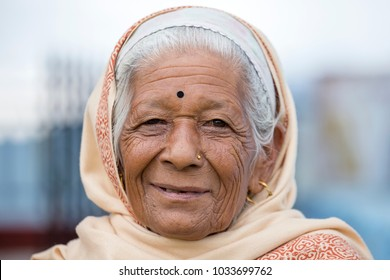 KATHMANDU, NEPAL - OCTOBER 05, 2016 : Portrait old women in traditional dress in street Kathmandu, Nepal